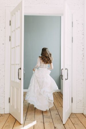 Beautiful girl in white dress, European wedding. Air and light photo shoot of the bride.