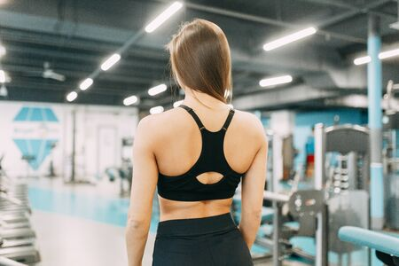 Beautiful girl in the gym. Sports and fitness, healthy lifestyle.