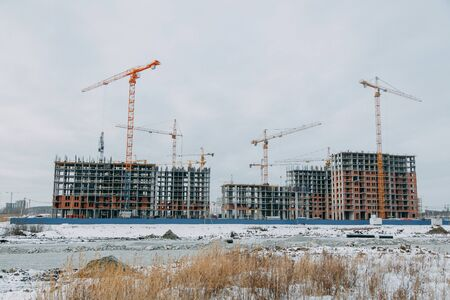 Construction of modern high-rise buildings. Phased construction of structures in winter.
