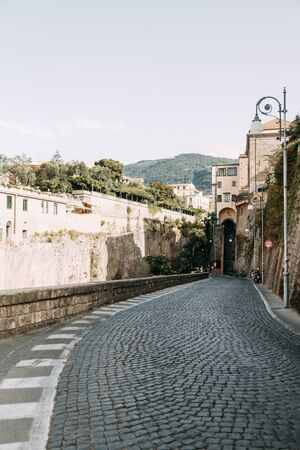 Views of the city of Sorrento in Italy, panorama and top view. Night and day, the streets and the coast. Beautiful landscape and brick roofs. Architecture and monuments of antiquity. Shops and streets with fountains and sculptures.