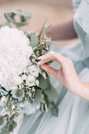 wedding decor with owls and printing, Bridal bouquet and rings Stock Photo