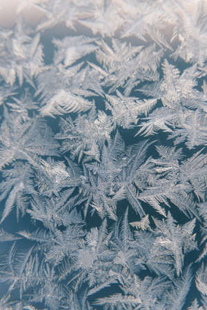 The texture of ice on frozen glass. Frosty natural pattern on the winter window.