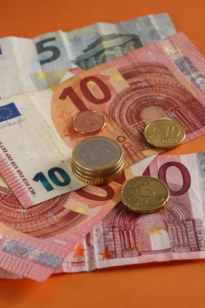 Euro coins and banknotes view from close up