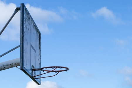Old street basketball ring against the sky