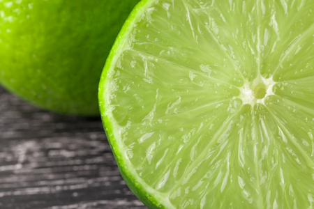 Sliced and whole fresh lime, a rich source of vitamin C, often used to emphasize food and drinks