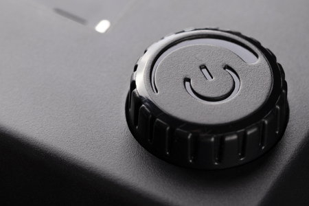 Power control, black button on and off electronic devices. From expensive plastic.