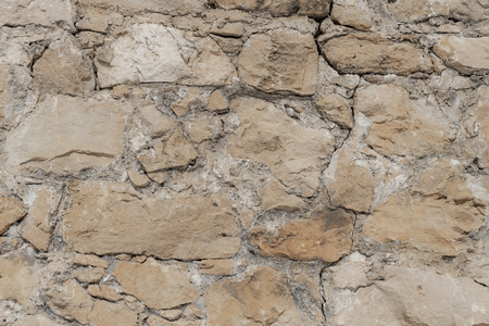 Construction background from a wall of stonework. The concept of strength for centuries