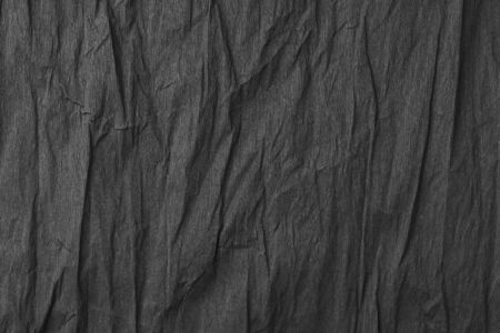 Black textured creased wrapping paper. Excellent background for design and lettering.