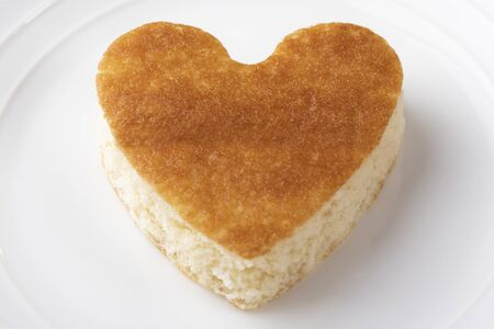 Cookies with a crisp in the shape of a heart on a white plate. Valentines Day and Wedding Concept