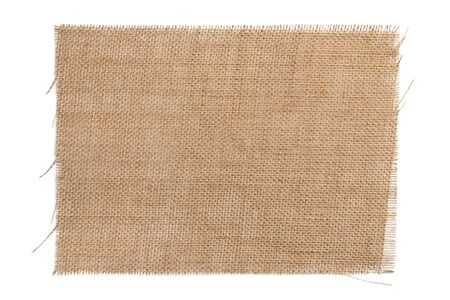 Old brown sackcloth from burlap. Wicker napkin isolated on a white background close-up. For design and titles