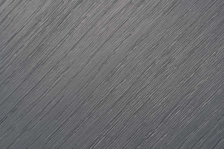 Textured gray painted wooden board close up with cracks