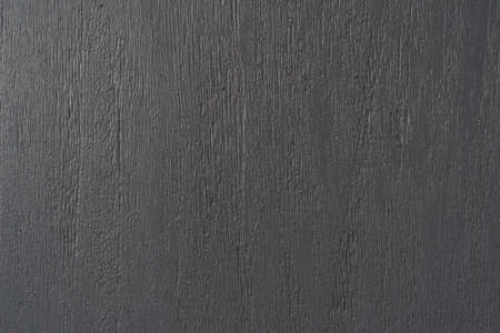 Texture of the wooden surface painted in gray. Close-up.