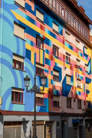 Oviedo, Spain, Asturias - August 2020: Building painted with vibrant geometric art patterns on a street in Oviedo, Spain