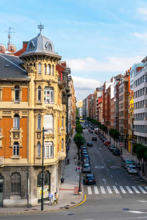 Oviedo, Spain, Asturias - August 2020: Beautiful old building in Oviedo on a city street. Residents are wearing medical protective masks. Coronavirus pandemic in Spain and Europe