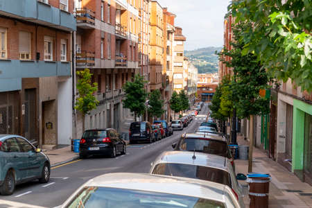 Oviedo, Spain, Asturias - August 2020: Narrow cozy street in a European city with parked cars