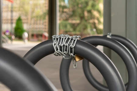 Chain lock close up on a bicycle parking