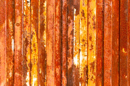 Old rusty zinc fence background close up