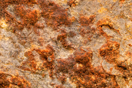 Brown yellow old stone texture. Corrosive and ancient background
