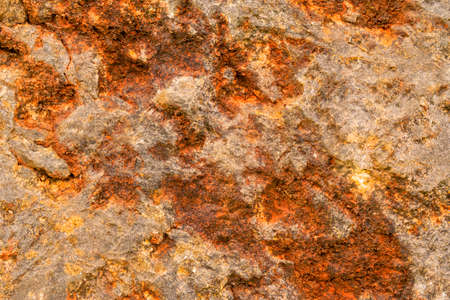 Grungy bright stone close up, rusty stone wall corrosion texture for web design and wallpaper background
