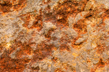 Rusty texture of old stone close up. Bright abstract background
