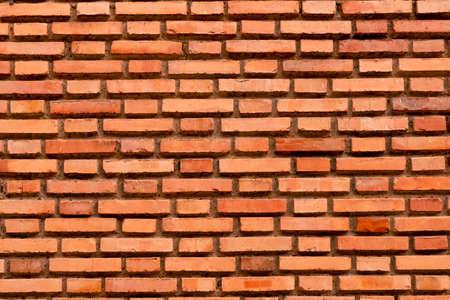 Old red brick wall background close up Фото со стока