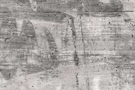 Old concrete wall. Grungy spotty background with many scratches Фото со стока