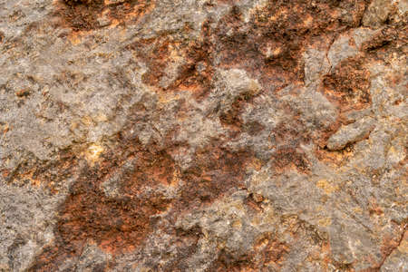 Stone texture. Rusty grungy weathered abstract background. Close-up of rock Фото со стока