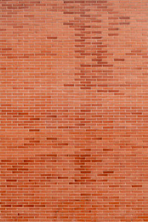 Brick background from brickwork. Spotted pattern in the distance Фото со стока - 156098977