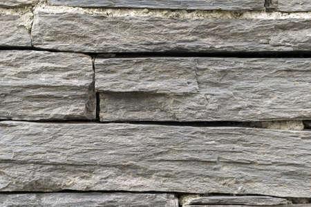 Black slate wall texture and background close up Фото со стока