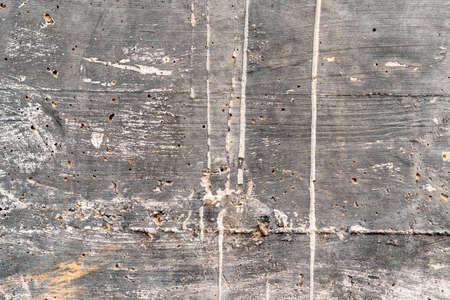 Old concrete wall. Grungy corroded background with many scratches, cracks, and paint stains Фото со стока - 156098980