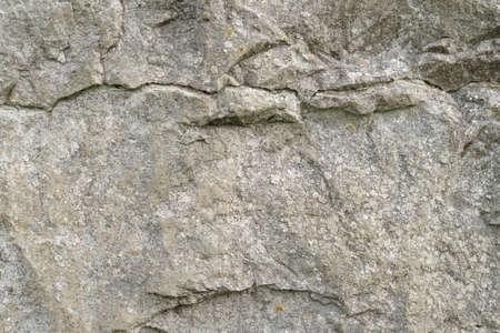 Grungy cracked stone texture from natural rock retro style. Weathered ancient wall background. Concept of aged building natural material Фото со стока - 156098997