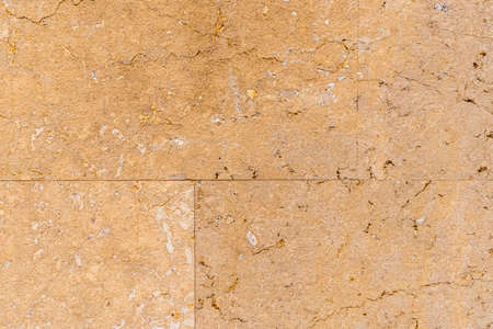 Old weathered beige wall tile with cracks in high resolution close up Фото со стока - 156099007