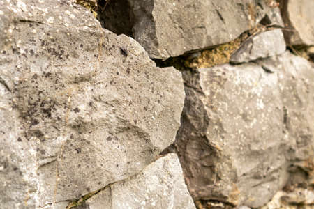 Stone wall texture abstract close up. Natural background. Selective focus Фото со стока - 156099009