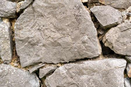 Stone wall texture abstract close up. Natural background Фото со стока - 156099010