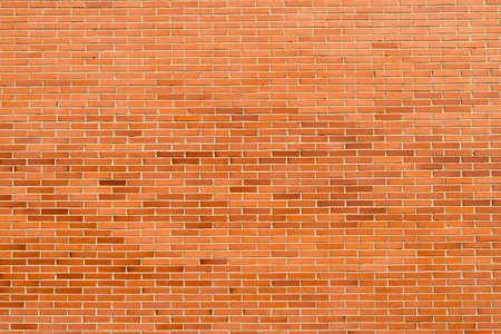 Brick wall, texture of red stone blocks background Фото со стока - 156099176