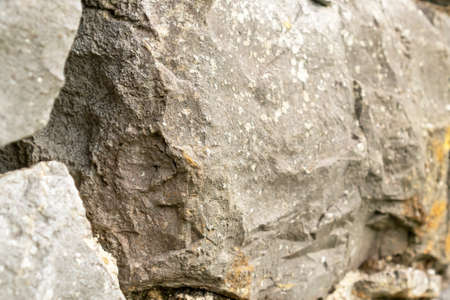 Close-up of natural large stones. Abstract texture. Selective focus. Фото со стока - 156099187