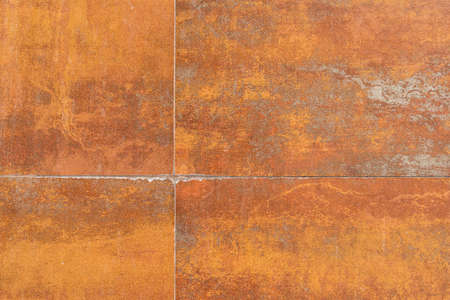 Rusty background texture with seams. Tiled stained rusty wall