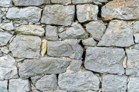 Rock wall background. Closeup. Copspace. Natural gray texture