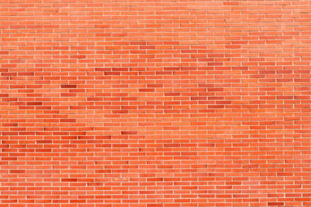 Brick background from brickwork. Spotted pattern in the distance