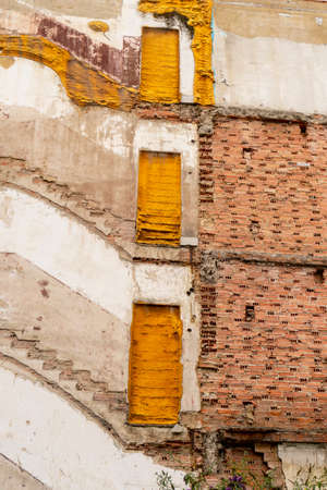 The destroyed wall of an abandoned residential building close-up. Preparing for the demolition of the old building Stock fotó - 156099214
