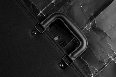 Black business briefcase on wrinkled dramatic black background. The concept of the global financial crisis and unemployment. Job search and coronavirus. Abandoned work accessory as a symbol of a laid off worker. Copy space Stock Photo