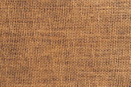 Burlap sackcloth close-up on a black background. Dark rustic background for design and menu