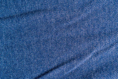 Texture of blue summer t-shirt close up