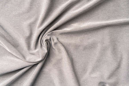 Crumpled wrinkled synthetic material. Abstract gray background. Polyester fabric