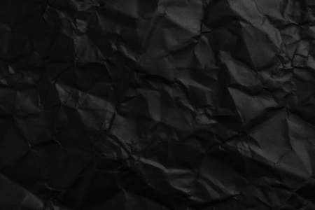 Crushed black paper dark abstract background