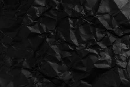 Blank crumpled and straightened black paper with wrinkles for design dark background Stock fotó