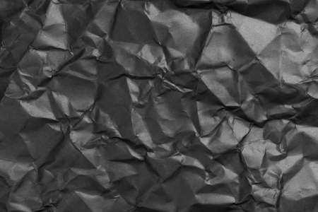 black crumpled wrinkled paper texture
