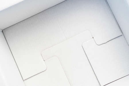 White cardboard packing box from the inside close up. Delivery concept of goods and products