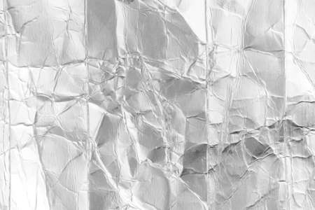 Abstract background. Used milk packaging for recycling. Inside view of aluminum foil. Environmental pollution concept Stock fotó
