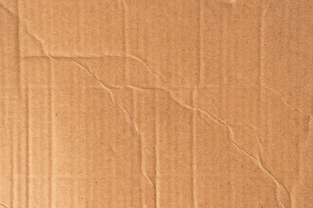 Brown crumpled cardboard texture. Crumpled shabby background. Packaging old material Stock fotó
